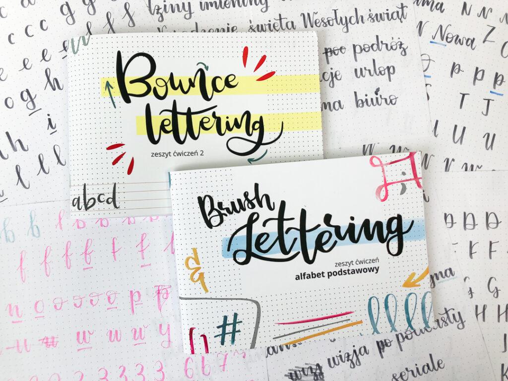 Kartki z napisami brush penami i 2 zeszyty do letteringu.